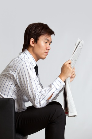 corporate themed image of a man reading photo
