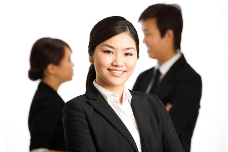 Business woman with colleagues at the back out of focus photo