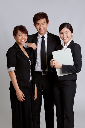 asian business team: Corporate themed image of business people