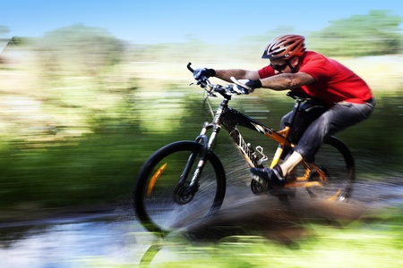 Man riding a mountain bike photo
