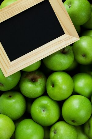 groupings: Green apples and a chalk board