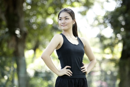 An Asian female runner ready to go running photo