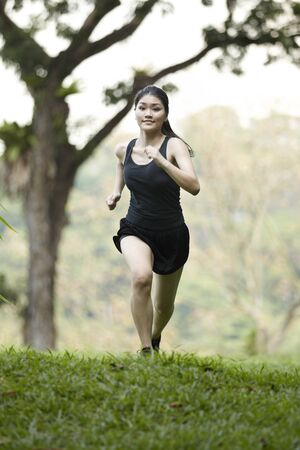 Picture of a woman running through the park. Stock Photo - 10443066