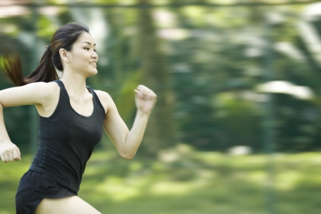 south asians: Picture of a woman running through the park.