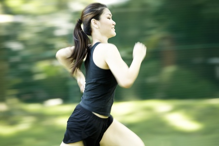 Picture of a woman running through the park. Stock Photo - 10443065