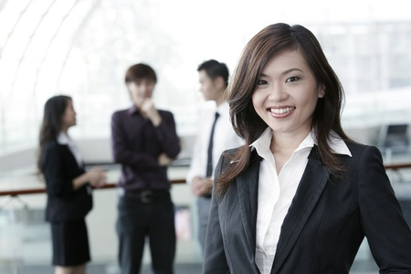 Asian Business colleagues standing in a row and smiling Stock Photo - 10526972