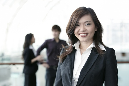 confident consultant: Asian Business colleagues standing in a row and smiling
