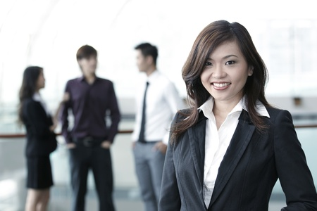 Asian Business colleagues standing in a row and smiling Stock Photo - 10526954