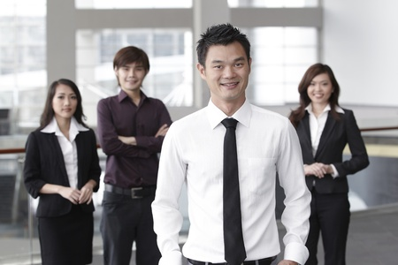 Asian Business colleagues standing in a row and smiling Stock Photo - 10526921