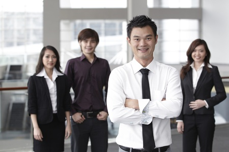 asian working woman: Asian Business colleagues standing in a row and smiling