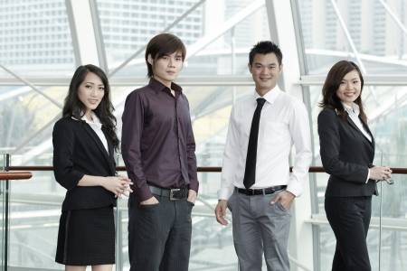 Asian Business colleagues standing in a row and smiling Stock Photo - 10527001