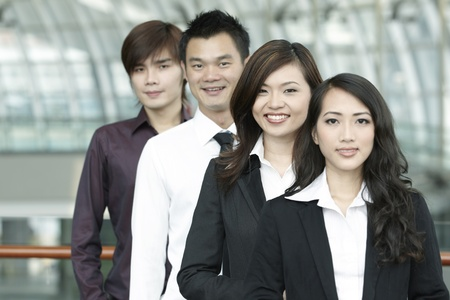 office workers: Asian Business colleagues standing in a row and smiling