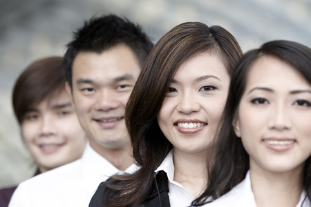 Asian Business colleagues standing in a row and smiling Stock Photo - 10526995
