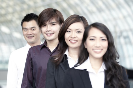 expertise: Asian Business colleagues standing in a row and smiling