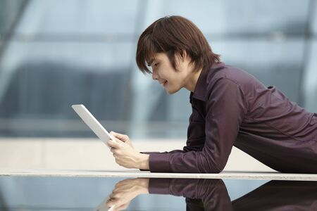 Asian Business man using a  touch pad PC Stock Photo - 10524996
