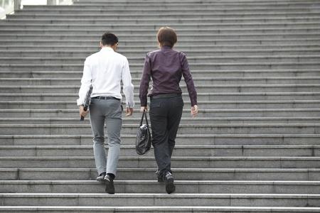man climbing: Two Asian Business men walking on stairs