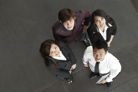 asian executive: High angle view of happy Asian business people Stock Photo