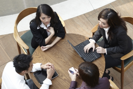 High angle view of Asian Business people having a meeting round a table.  photo