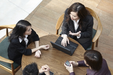 High angle view of Asian Business people having a meeting round a table. Stock Photo - 10525261