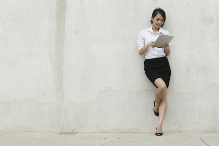 Asian  Business woman using a Digital Tablet Stock Photo - 10529994