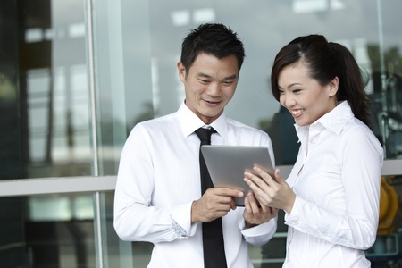 Asian  Business people using a Digital Tablet photo