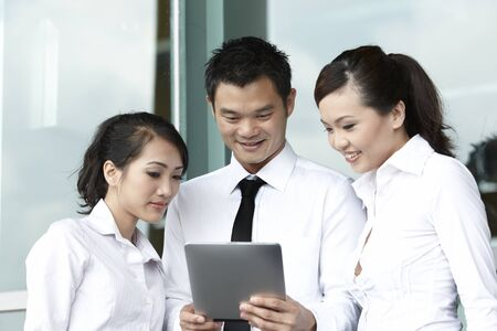Asian  Business people using a Digital Tablet Stock Photo - 10550009