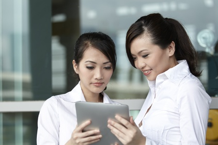 asian business people: Asian  Business woman using a Digital Tablet
