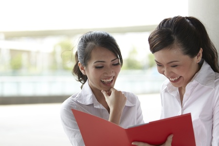 asian business women: Pretty Asian Business women reading a folder