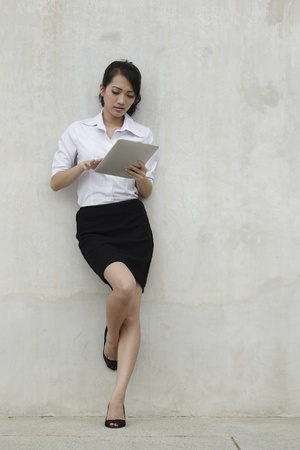 Asian  Business woman using a Digital Tablet photo