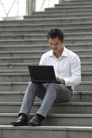 Asian Business man using a laptop Stock Photo - 10670211