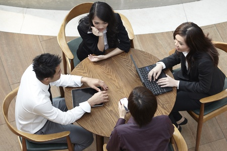 High angle view of Asian Business people having a meeting round a table. Stock Photo - 10670215