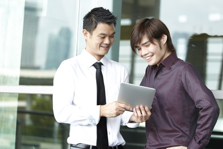 palmtop computer: Asian business people using a Digital Tablet computer