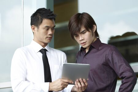 Asian business people using a Digital Tablet computer Stock Photo - 10670224