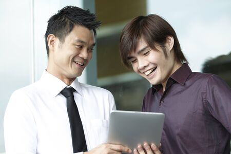 Asian business people using a Digital Tablet computer  photo