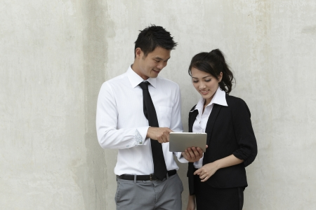 Asian business people using a Digital Tablet computer Stock Photo - 10670250