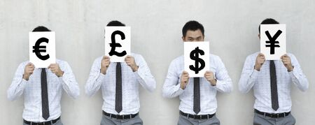 price uncertainty: Asian Businessman holding signs with currency symbols Stock Photo