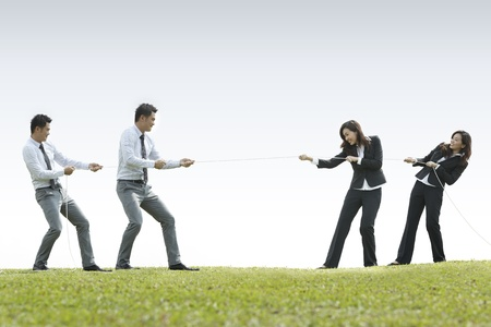 Conceptual image, Asian Business man and woman playing tug of war Stock Photo - 10906776