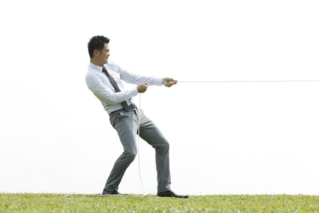 pulling rope: Conceptual image, Asian Business people playing tug of war