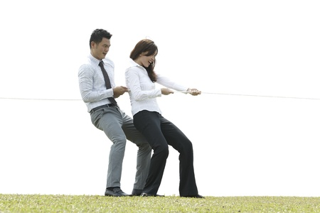 Conceptual image, Asian Business people playing tug of war photo