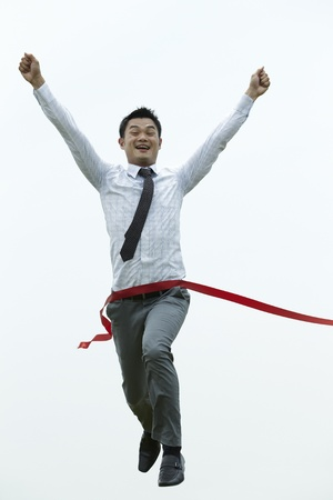 east end: Conceptual image of an Asian Business man winning a race