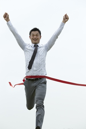 end of the line: Conceptual image of an Asian Business man winning a race