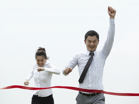 red competition: Conceptual image of an Asian Business man winning a race