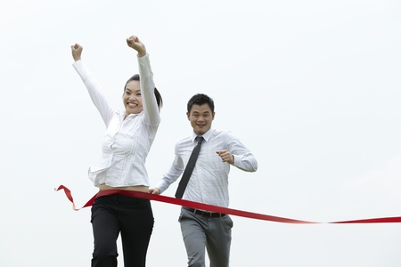 reward: Conceptual image of an Asian Business woman winning a race