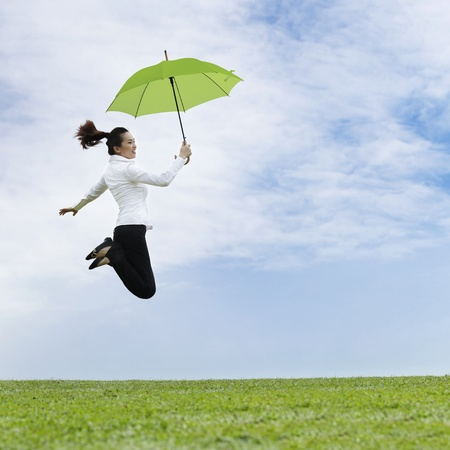Asian business woman jumping for joy Stock Photo