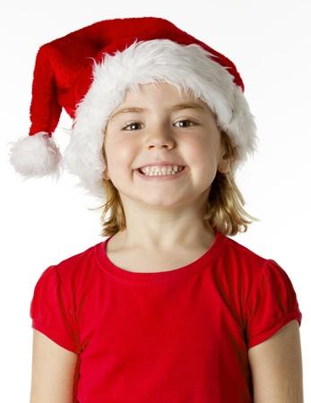 santa cap: Christmas kid in Santa hat on white background