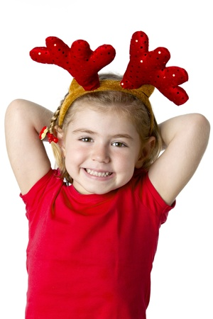 Christmas kid in Santa hat on white background photo
