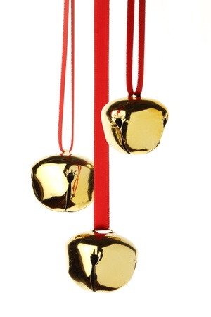 jingle bells hanging on red ribbon, isolated on white Stock Photo