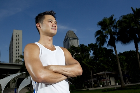 Asian man standing outside ready to exercise Stock Photo - 11515624
