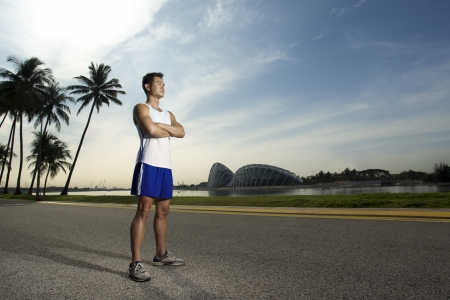 Asian man standing outside ready to exercise Stock Photo - 21879210
