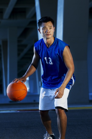 Asian male Basket ball Player at night photo
